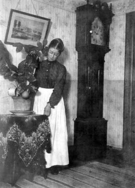 Adah Burkholder in her home. Adah later married