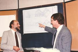 Rod Sawatsky reviewing building plans