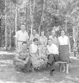 A formal photograph of several adults at an