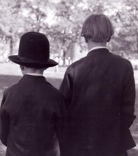 Two Old Order Amish boys from the back showing