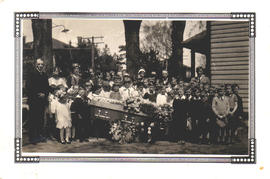 Children surrounding the open casket of Walter