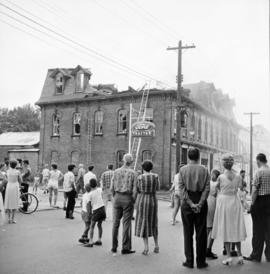 . A crowd standing on the street in New Hamburg, Ontario during a fire