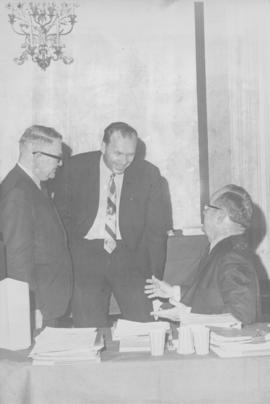 Note on back: J.H. Unruh (left), MCCC rep. &