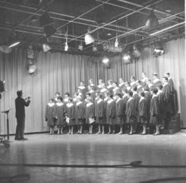 A cappella choir of CMBC in a recording studio.