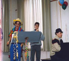 Students perform at a birthday party for Conrad Grebel College