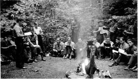 Conscientious objectors singing around a fire