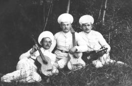 Abram Kroeger and friends holding musical instruments