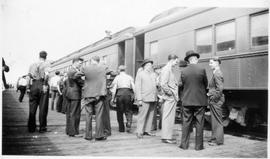 Alternative Service workers boarding a train
