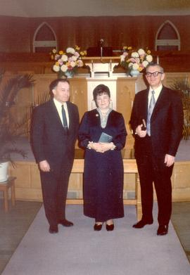 J. K. Klassen, pastor at right.  Photo (in