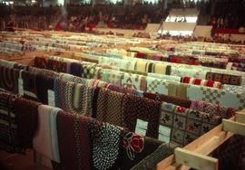Rugs and quilts on display at the Ontario Mennonite Relief Sale, 1974