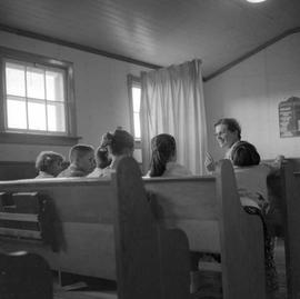 Children and teacher in Sunday School at the