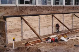 Shoring up a retaining wall for the construction