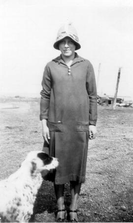 Lottie Young standing with a dog.  Lottie Young