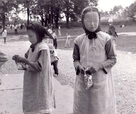 Two Old Order Amish girls in customary dress.