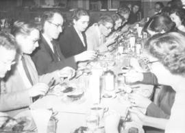 Canadian students, workers and conference delegates share a meal in Newton, Kansas