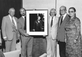 Hanging of Fretz presidential portrait