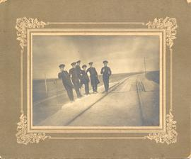 Young men on railroad under construction