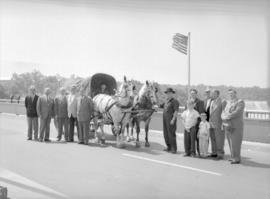 A group of men and children standing with the horse and wagon during the reenactment of the Trail of the Conestoga