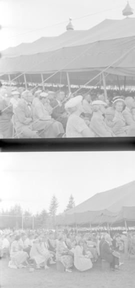 People seated outside the tent at the Brunk Revival Campaign in British Columbia