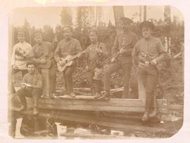 Group of forestry workers holding various musical instruments