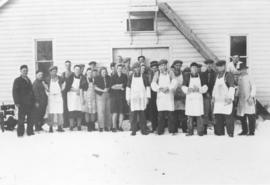 Workers in front of the Pembina Co-operative Cannery Ltd. at Rhineland, Man