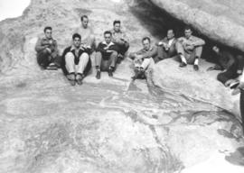 Members of the I-W Unit in Colorado sit on rocks