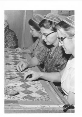 Mennonite women working on a quilt for the Mennonite Relief Sale