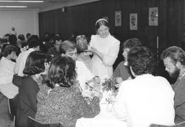 A server and diners at the alumni banquet, 1987