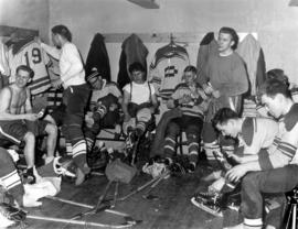 Conrad Grebel College hockey team dressing for a