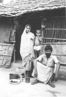 Santoch Kumar with his wife and child