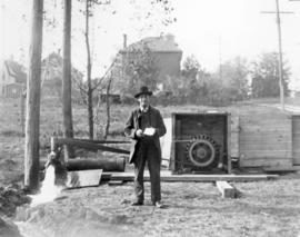 Abraham M. Bowman with newly drilled well.