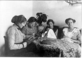 "Young women doing handwork and having a ""cozy"