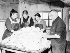 Mennonite Central Committee canning chickens in