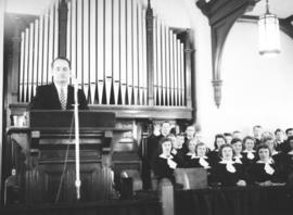 C.J. Dyck in the pulpit with the youth choir