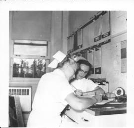 Marion Landis and Vera Snyder at the nurses station