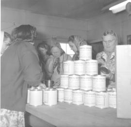 Women from the Hesston churches washed the sealed cans & labelled them