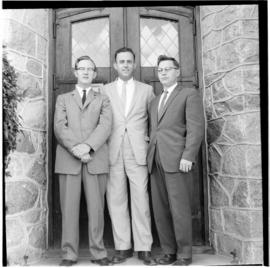 L-R: Frank H. Epp (photographer at retreat?), H.