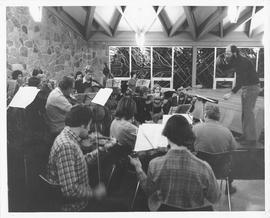William Janzen leading an orchestra rehearsal