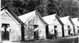 Cabins and men at Seymour camp