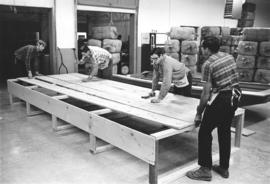 Building a packing crate for a boat to be sent to East Pakistan