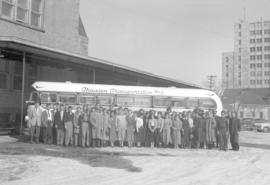 CMBC choir of  Wpg., on tour (in Sask.?) in front