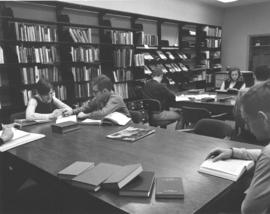 Conrad Grebel College students in the library.