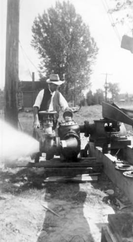 Abraham M. Bowman with pumps at new well at