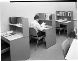 Student working in the study room at Conrad Grebel College