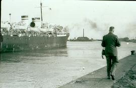 Ship load headed for South America C.F Klassen walking along side