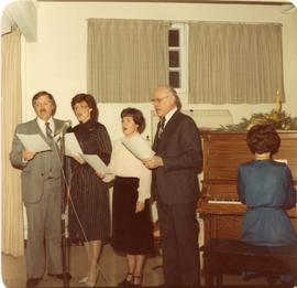 A group of four singing
