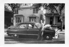 Peter Koop with his car at 46 Cobourg Ave