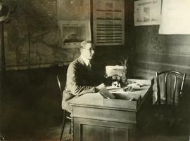 American Mennonite Relief Worker at desk