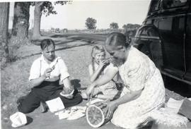 Peter, Heidi, Mary eating watermelon by the side of the road
