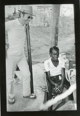 Dave Paulovich talking with a student at Hampton School, Jamaica
